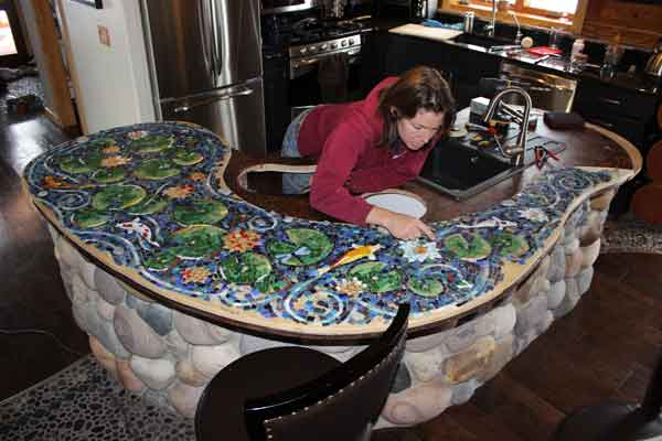 mosaic artist with bar