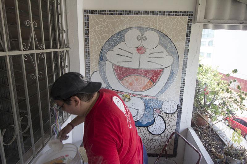 Artist Grouting Mosaic Doraemon