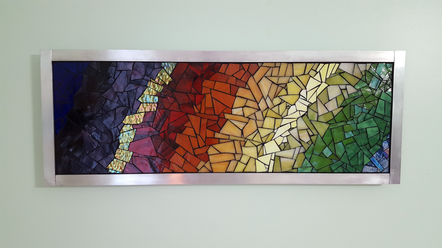 """Energy"" mosaic art mounted on wall with french cleat."