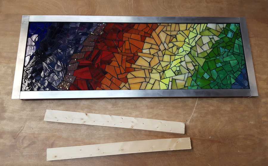 """Energy"" mosaic art and two pieces of wood for french cleat wall mount system."