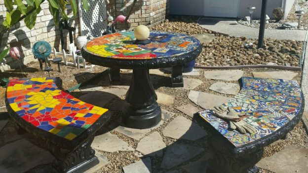 Mosaic Patio Table with bench seats by Naomi Haas.