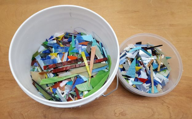 stained glass shards in buckets