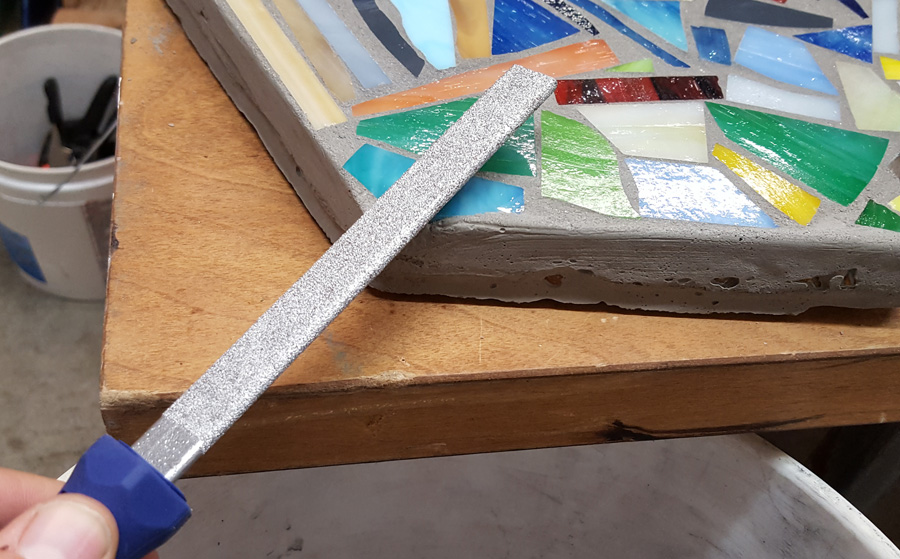 filing a sharp edge with ceramic and marble file