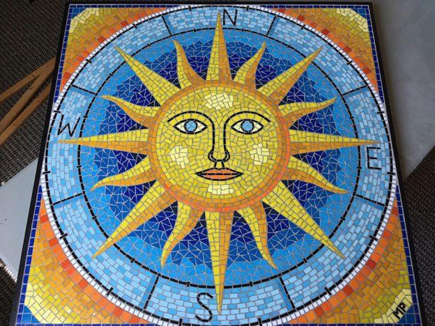 "Artist Marie Powell's ""Sun Compass"" mosaic table top"