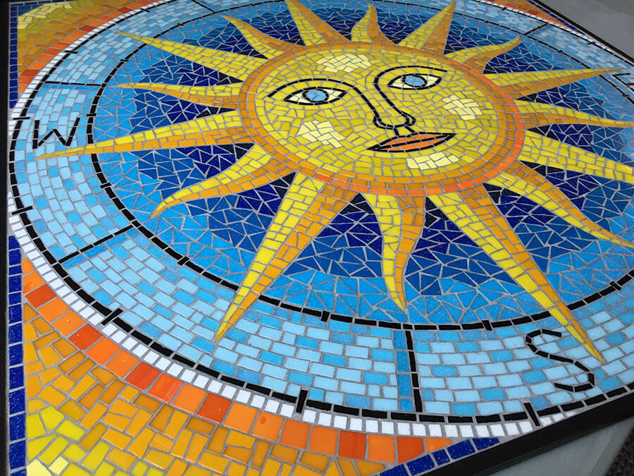 "detail from Artist Marie Powell's ""Sun Compass"" mosaic table top"