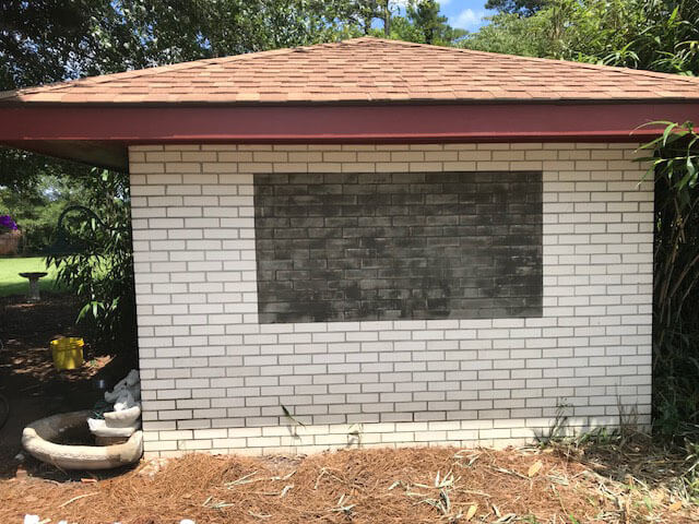 Brick wall smoothed with thinset mortar