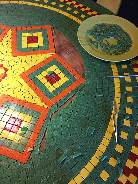 Mosaic Dining-Room Table being tiled.