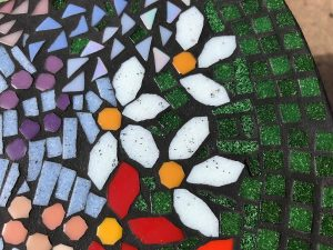 "Mosaic table by Julie Landberg showing grout ""stain"" in superficial pitting of vitreous glass mosaic tile."